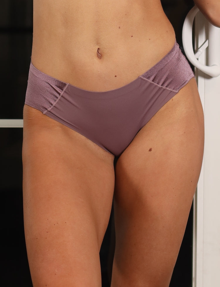 aileen boyshort- everyday seamless bikini panty featuring two wide satin panels on the sides  material and care:  hand wash recommended use a mesh bag when opting for machine wash imported nylon/spandex