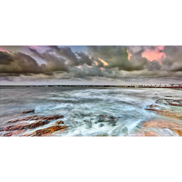 Stormy skies with a hint of pink at sunset over Nightcliff Jetty.