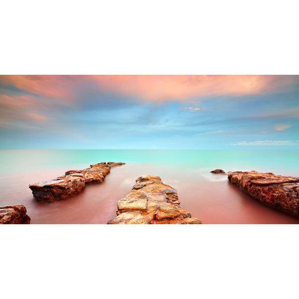 Soft pastels fill the morning sky over the rock formations of the Nightcliff foreshore.