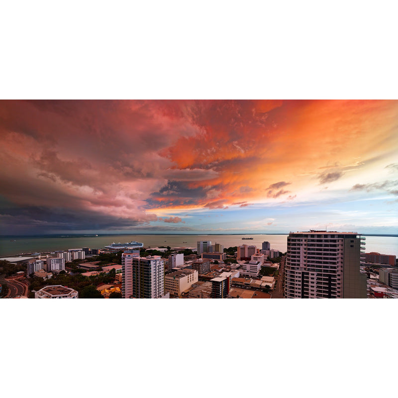 Reds and oranges of a stormy sunset over Darwin city and the Harbour.