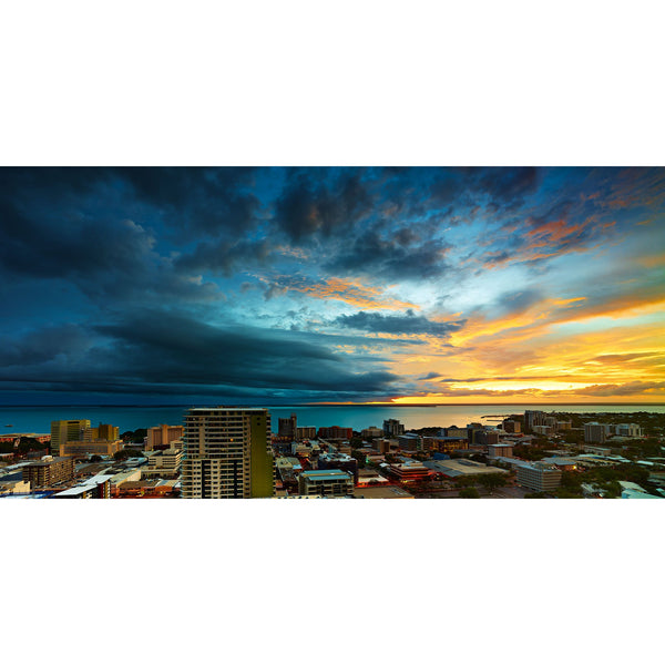 Yellow sunset set against a departing storm front over Darwin Harbour and Darwin City.