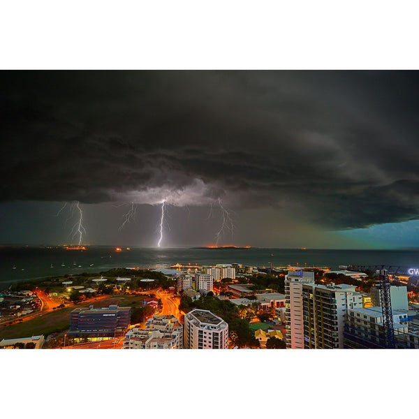 Triple bolts of lighting strike at night time over Darwin City.