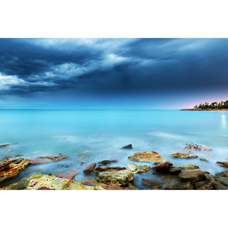 Blue hues over still waters at Nightcliff Beach
