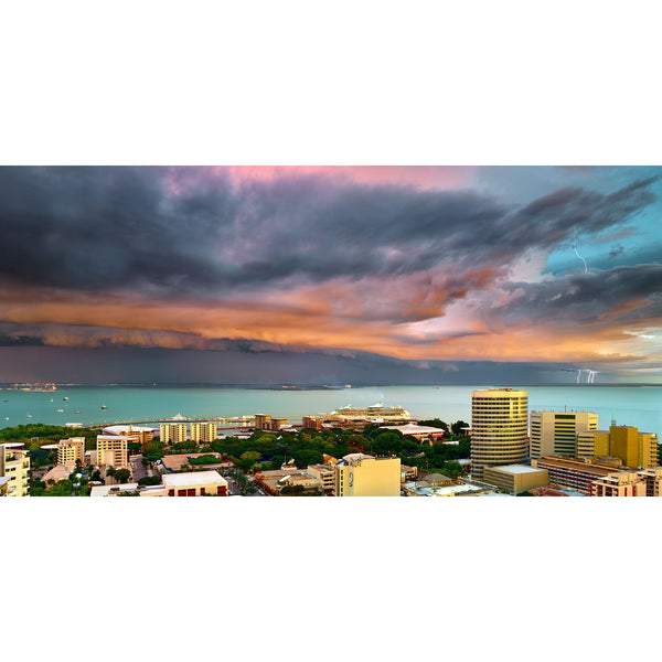 Pink storm clouds and triple lighting bolts over Darwin Harbour and the city.