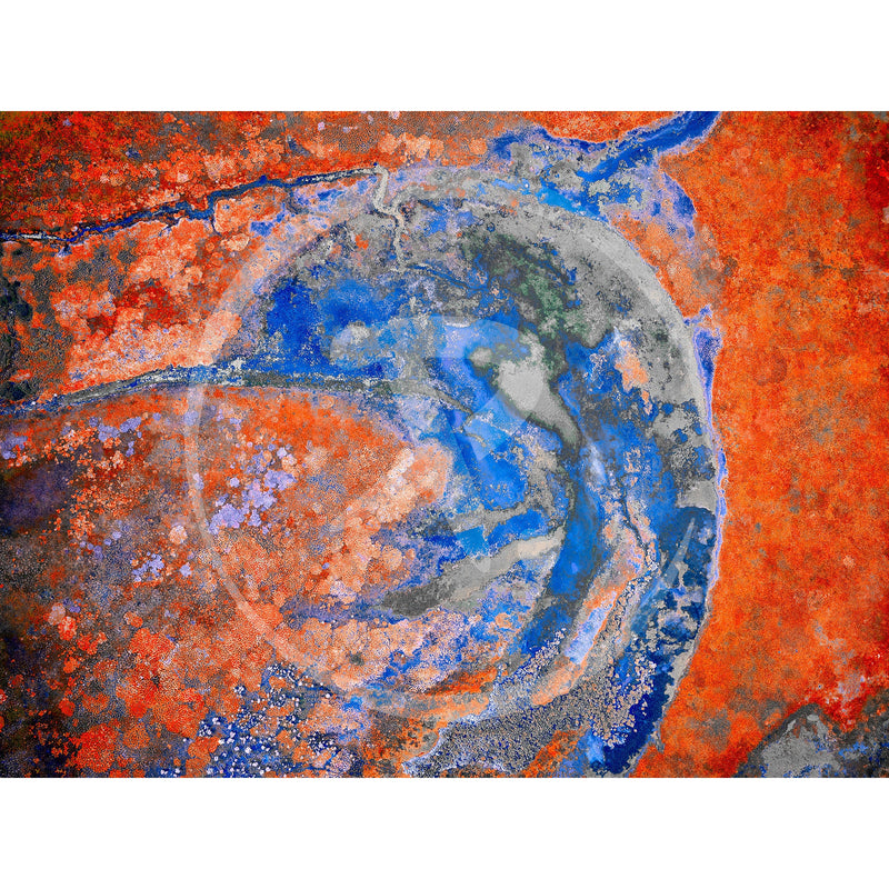 Aerial artwork of deep reds and oranges highlight the white tracks left by the tracking of cattle to and from the water point.