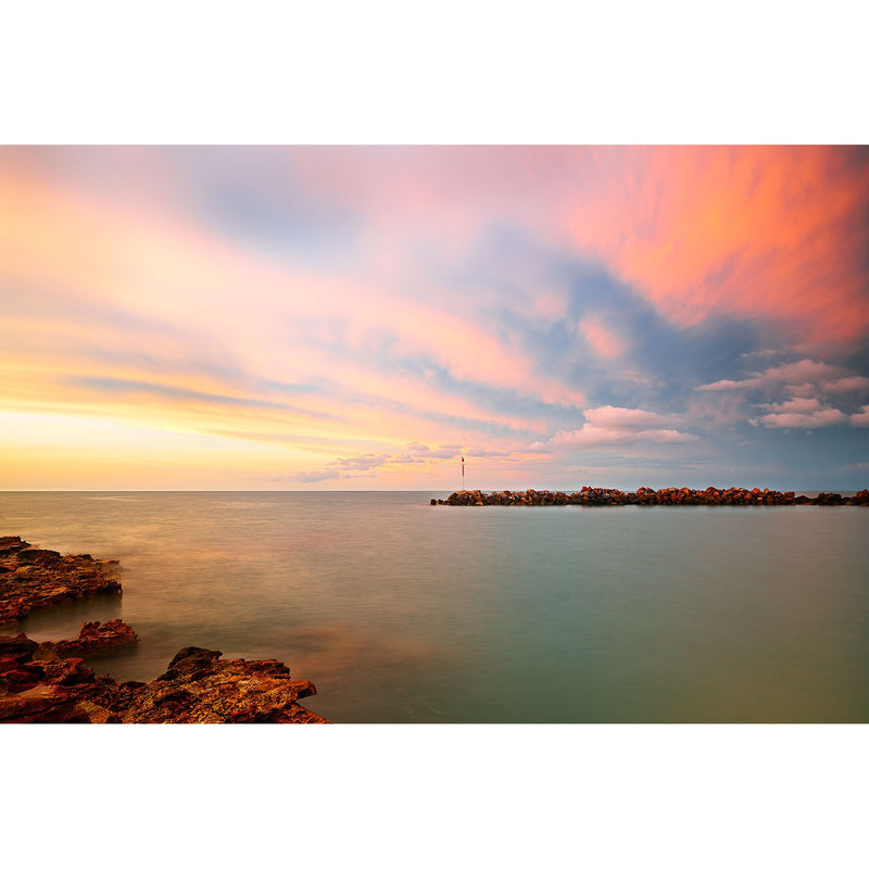 Magenta hues over Nightcliff boat ramp at sunset.