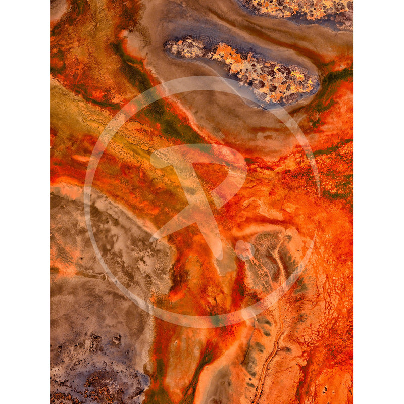 Aerial artwork of fiery reds across a Northern Territory floodplain.
