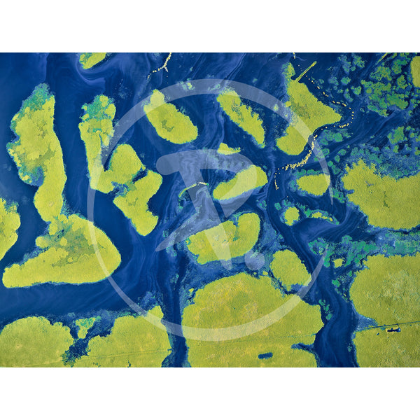 Aerial artwork of green islands of grass surrounded by the blues of wet season flood waters.