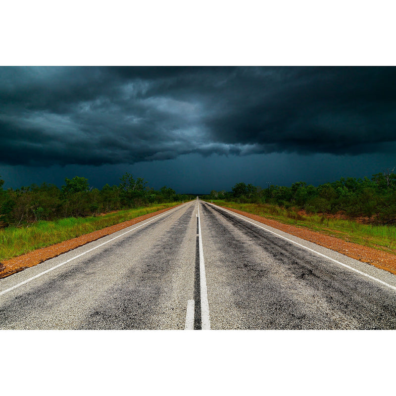 Black storm clouds over the Stuart Highway.