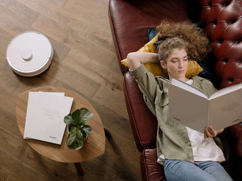 Woman Relaxing on Brown Leather Couch