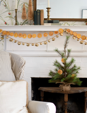 Dried citrus garland draped on a fireplace.