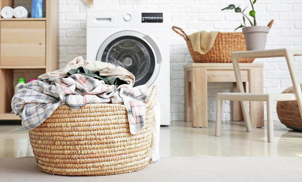 Laundry basket in a clean, white laundry room