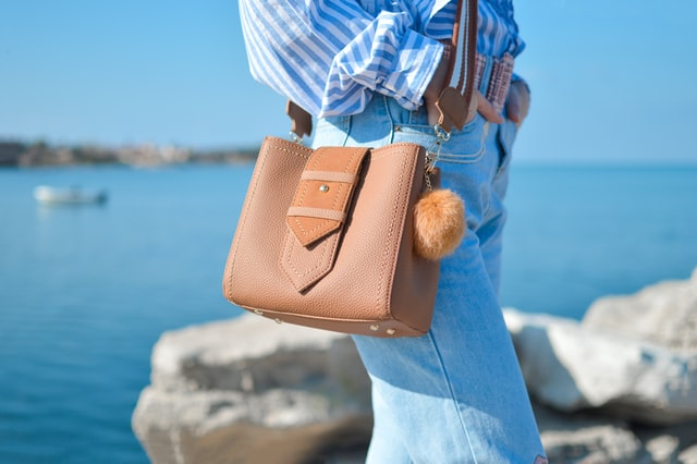 leather purse carried by woman seaside