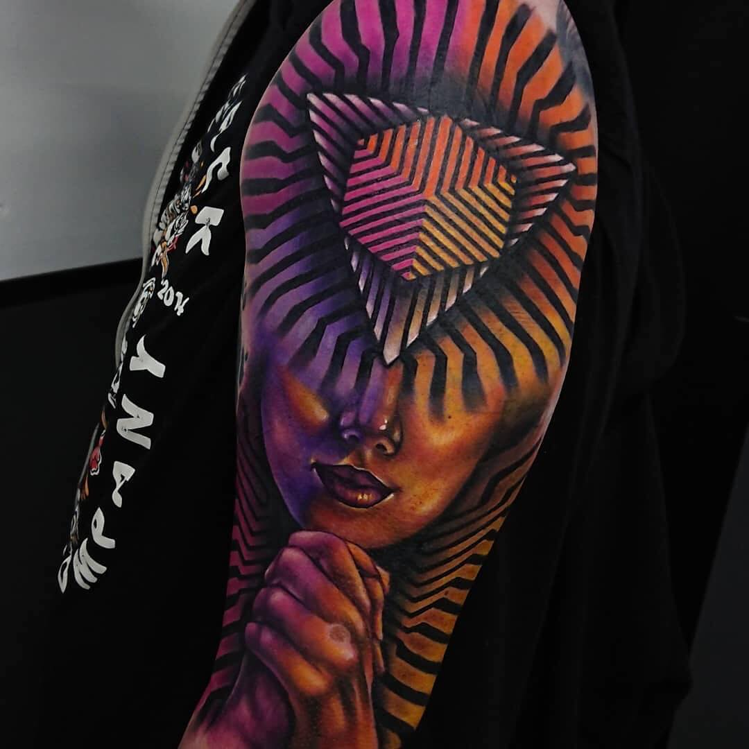 Colour Geometric Shape Tattoo combined with a Womans Face by Paul Vander-Johnson