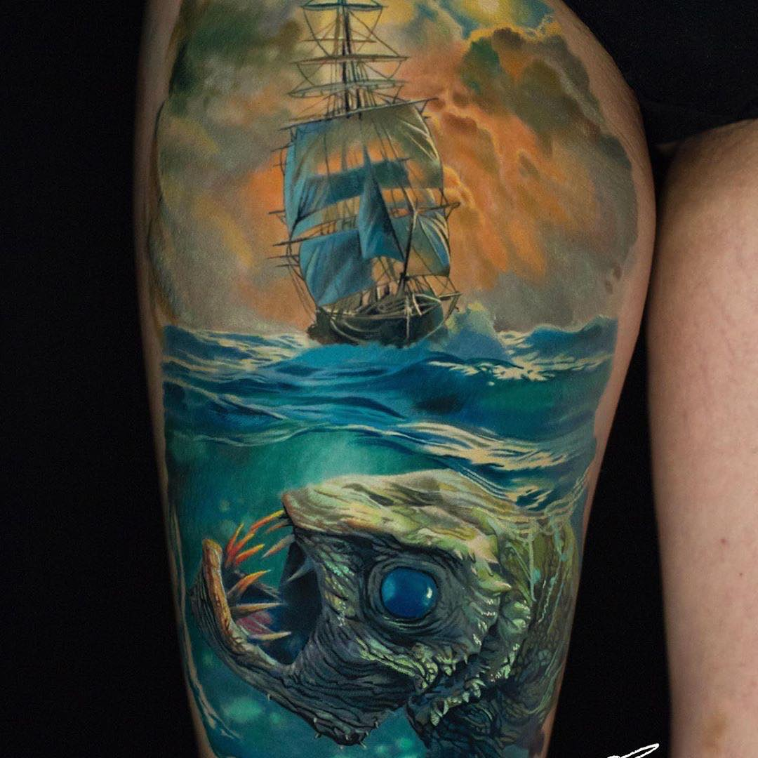 Colour Realism Sleeve Tattoo of a Long Ship and Deep Sea Monster Fish