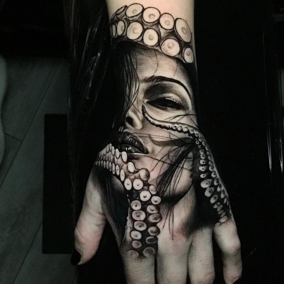 Black & Grey Realism Hand Tattoo of a Woman Wrapped in Tentacles