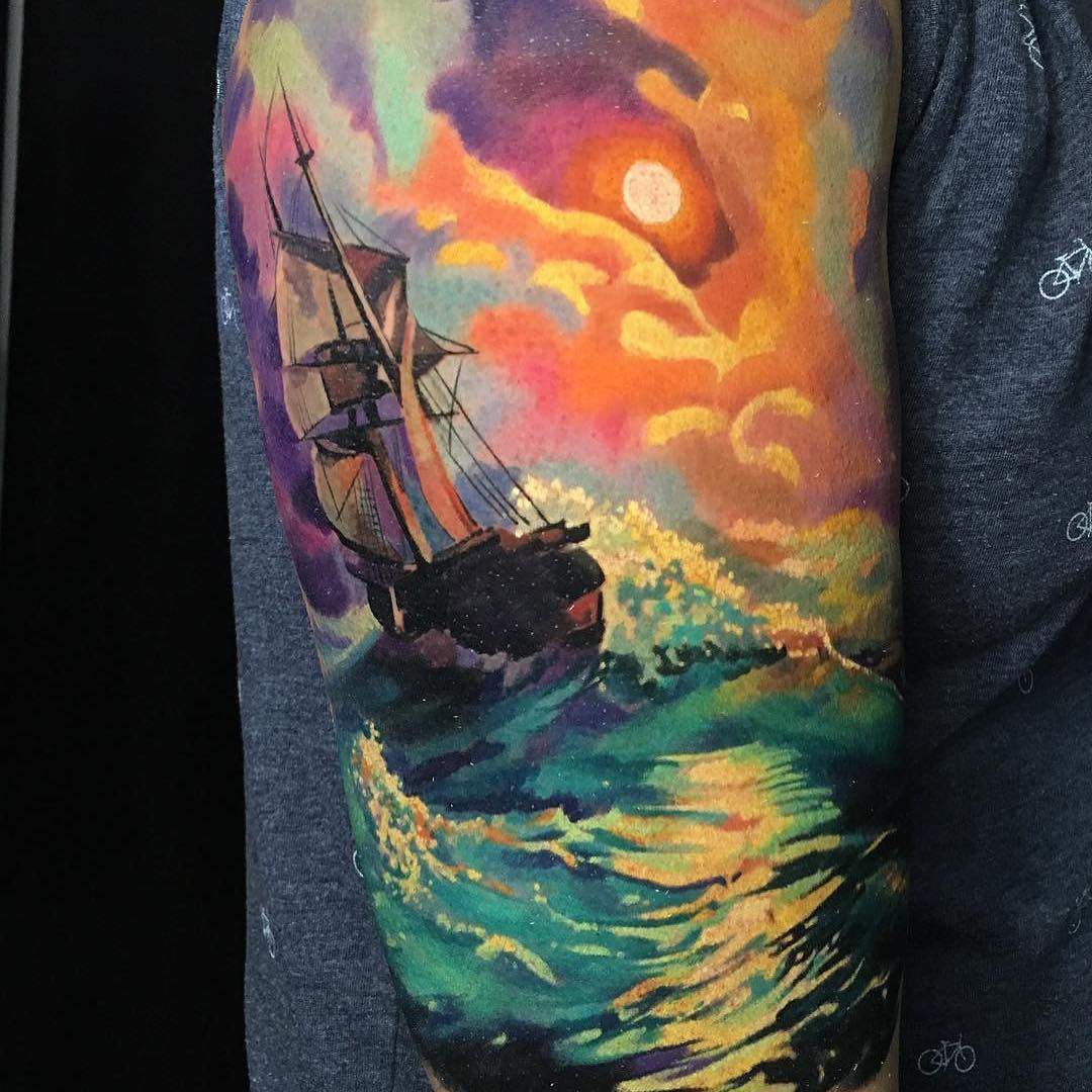 Colour Realism Arm Tattoo of a Long Ship in the Ocean