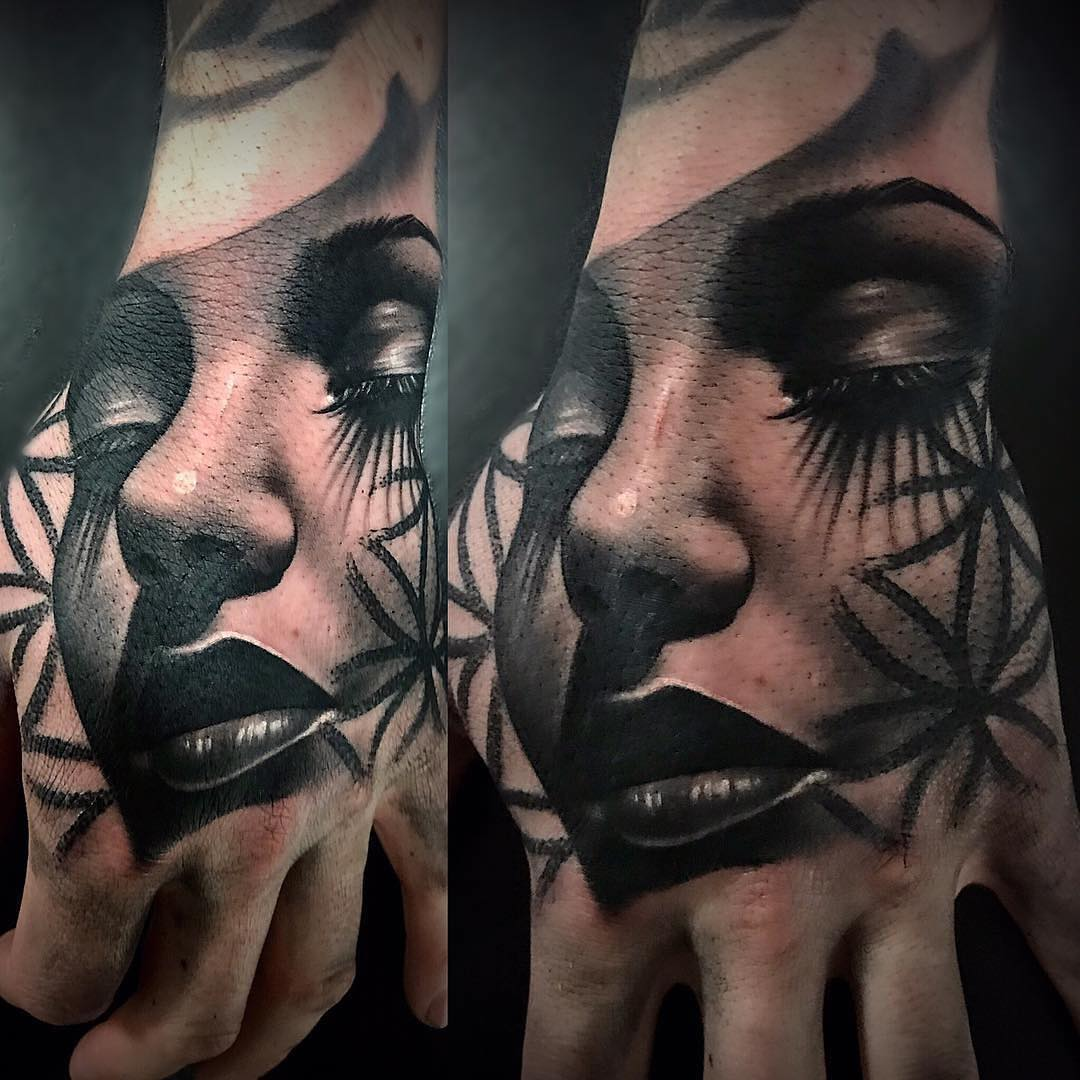 Black & Grey Hand Tattoo of a Female Face and Geometry by Martin Couley