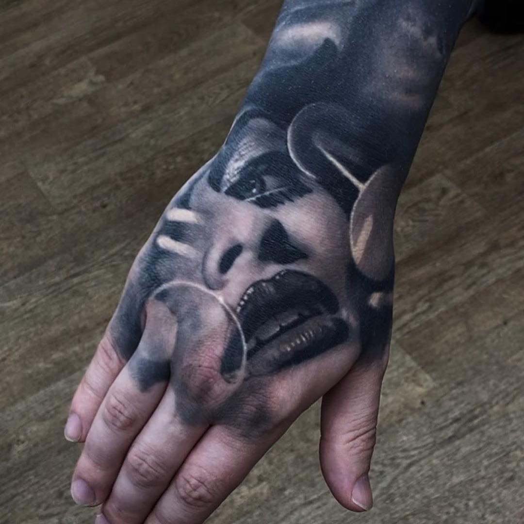 Black & Grey Hand Tattoo of a Womans Face by Tom Farrow