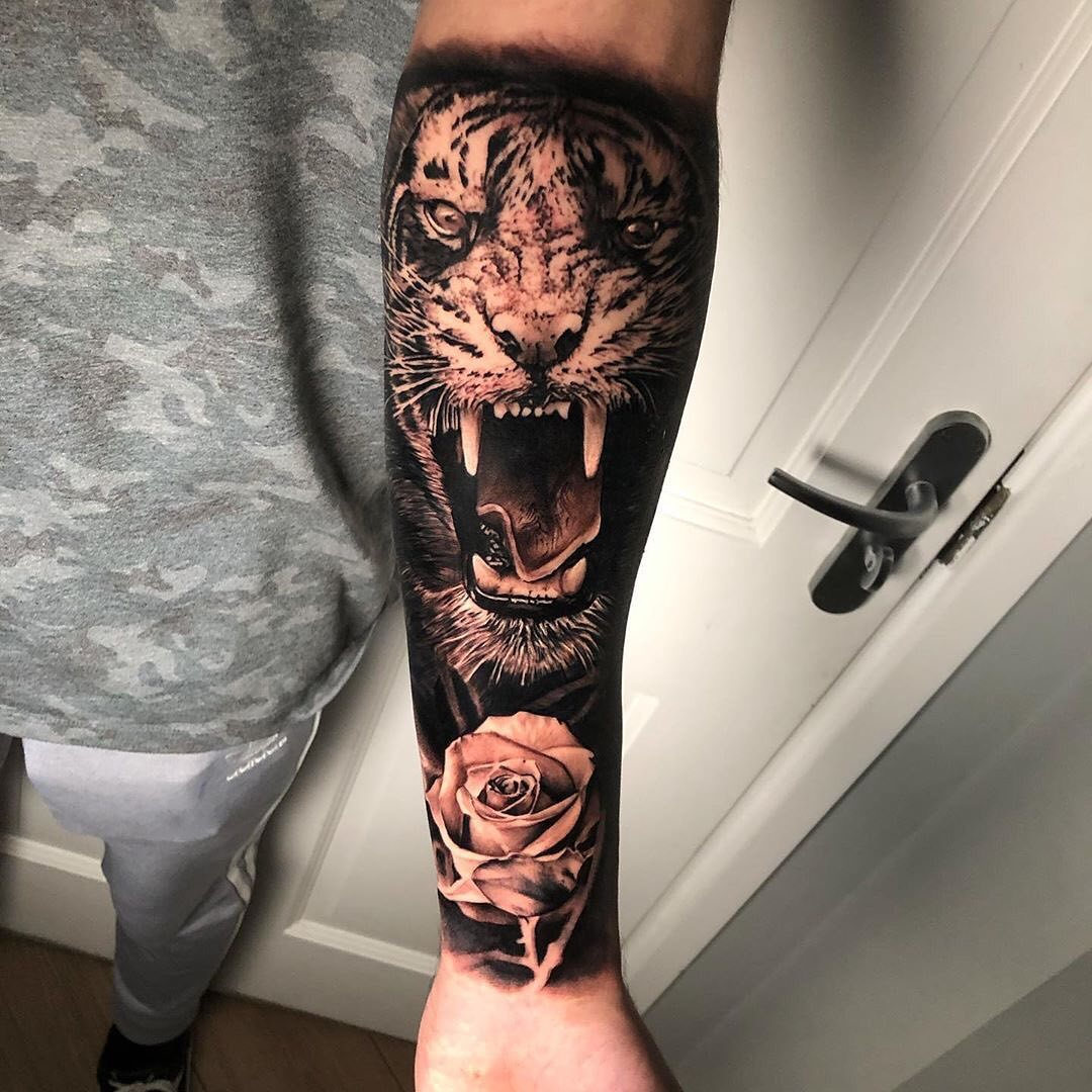 Black & Grey Arm Tattoo of a Tiger and Rose by Tom Stephenson
