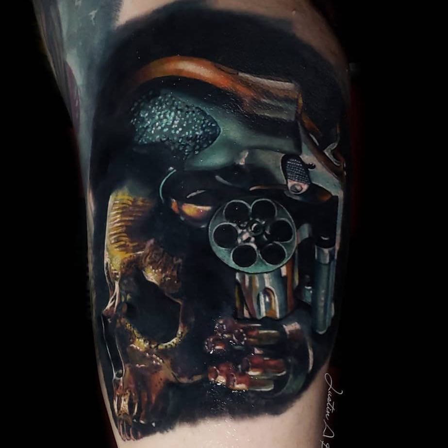 Colour Tattoo of a Skull & Revolver