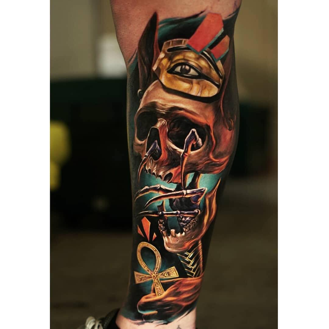 Egyptian themed colour skull tattoo
