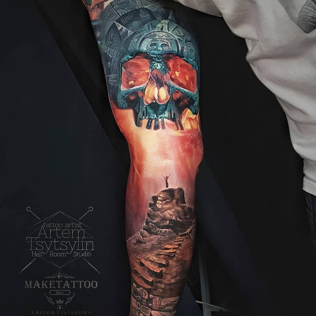 Colour Arm Tattoo of an Inca Skull by Artem Tsytsylin