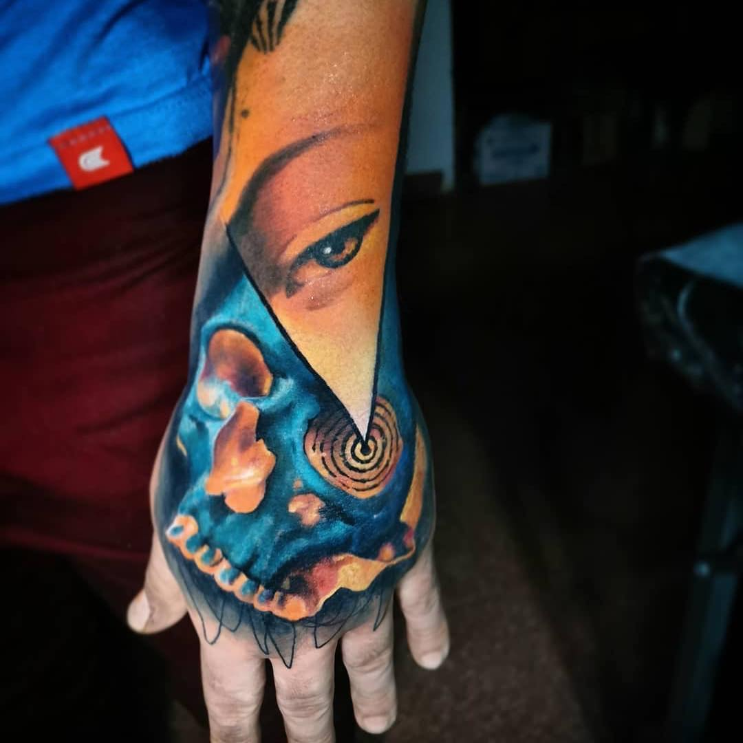 Colour Hand Tattoo of Skull & Eye by Tin Machado
