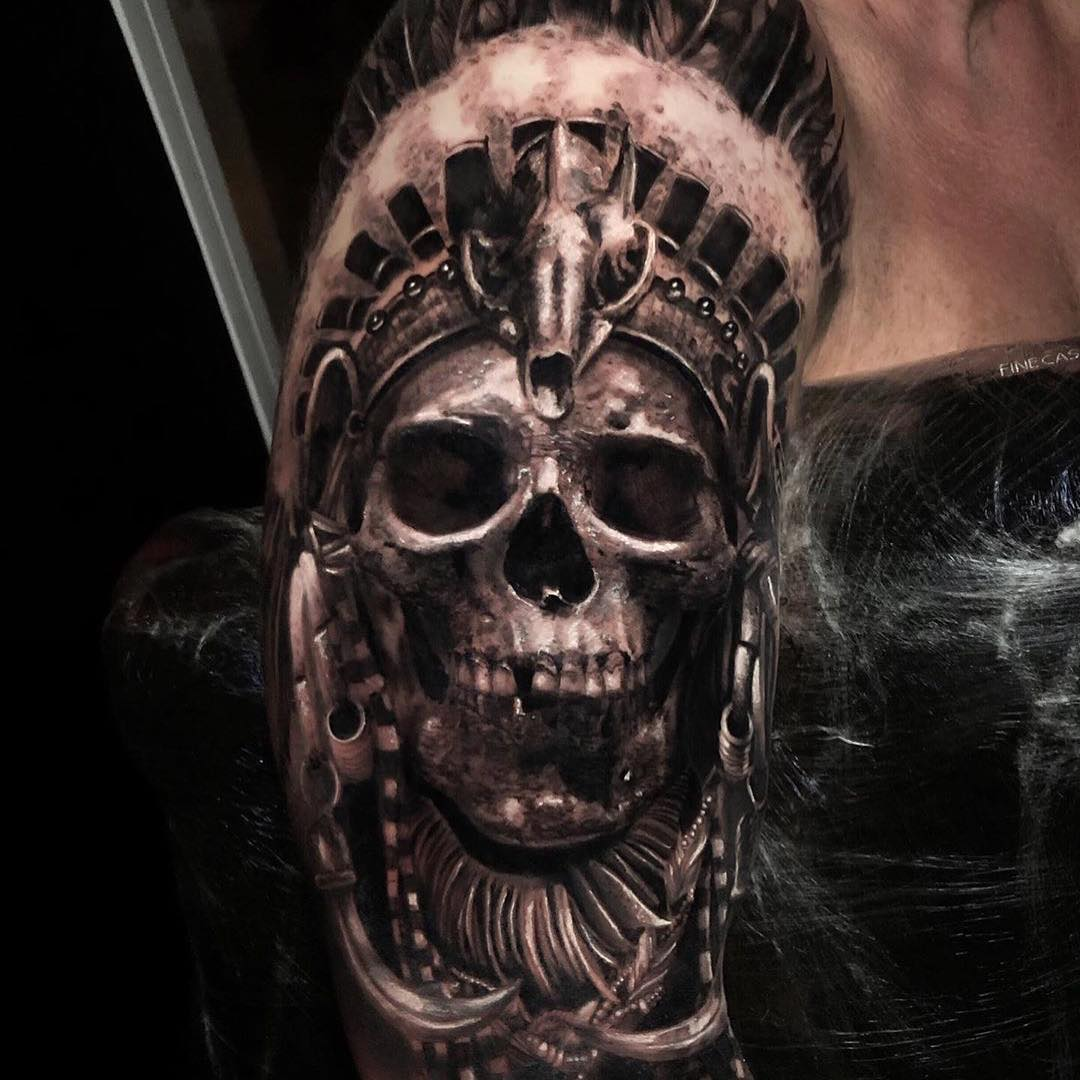 Tattoo of Skull in Indian Headdress by Tobias Agustini