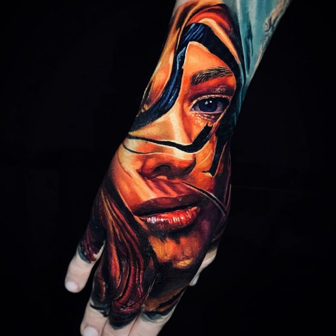 Colour Realism Hand Tattoo of a Female Portrait by Allen Brunn