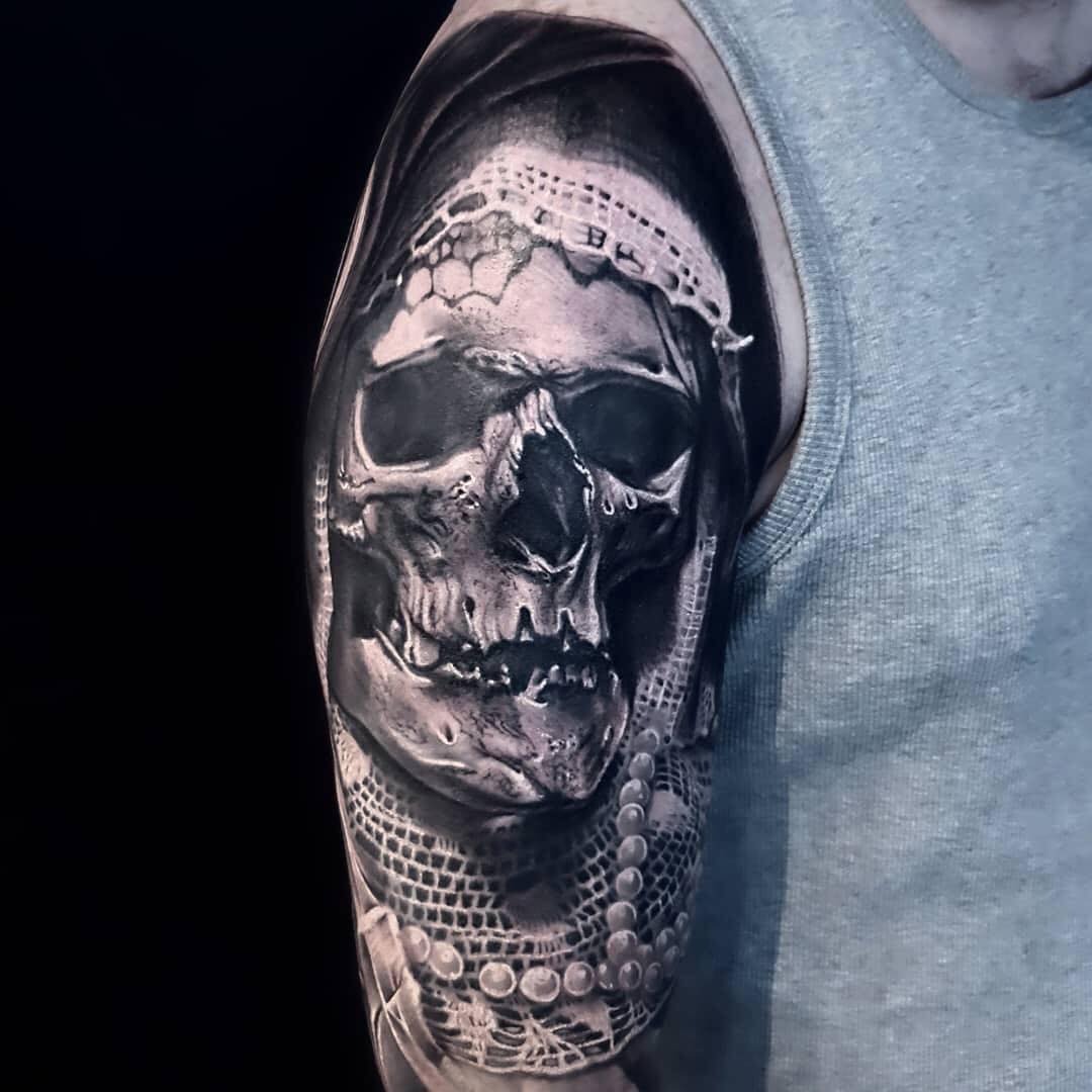 Black & Grey Realism Tattoo of a Skull in Shrowd