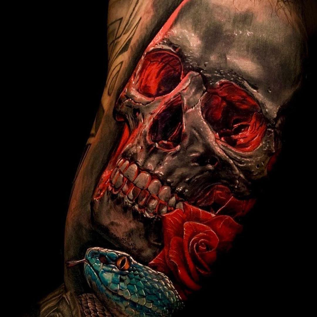 Colour Tattoo of a Skull, Rose & Snake with a red tint
