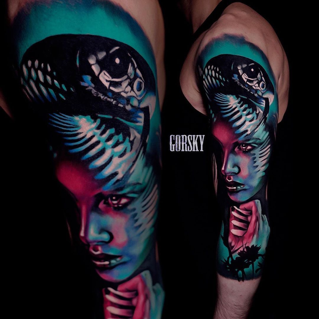 Colour Realism Tattoo of a Snake and Woman