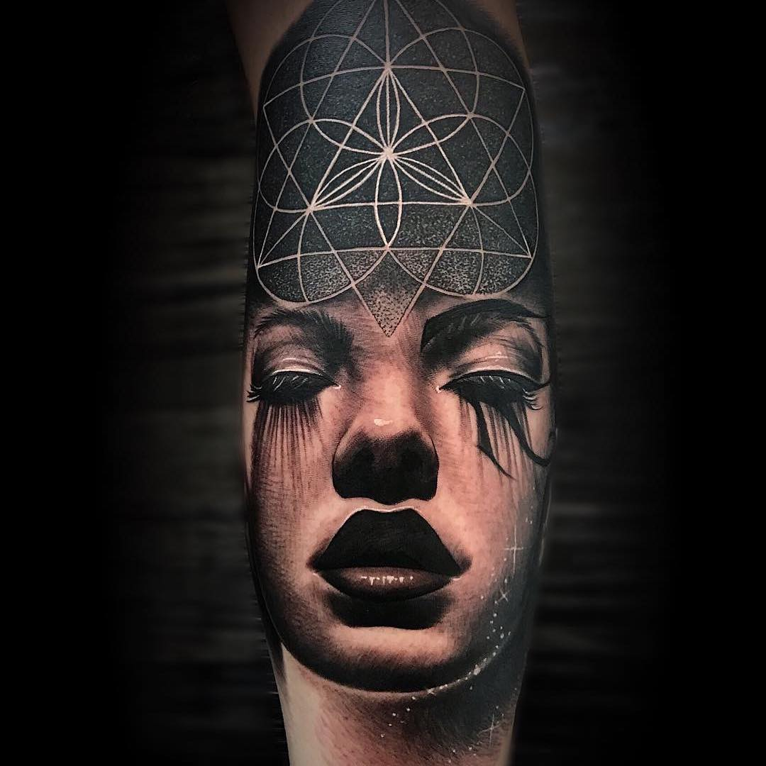 Black & Grey Geometric Tattoo combined with a Womans Face by Martin Couley