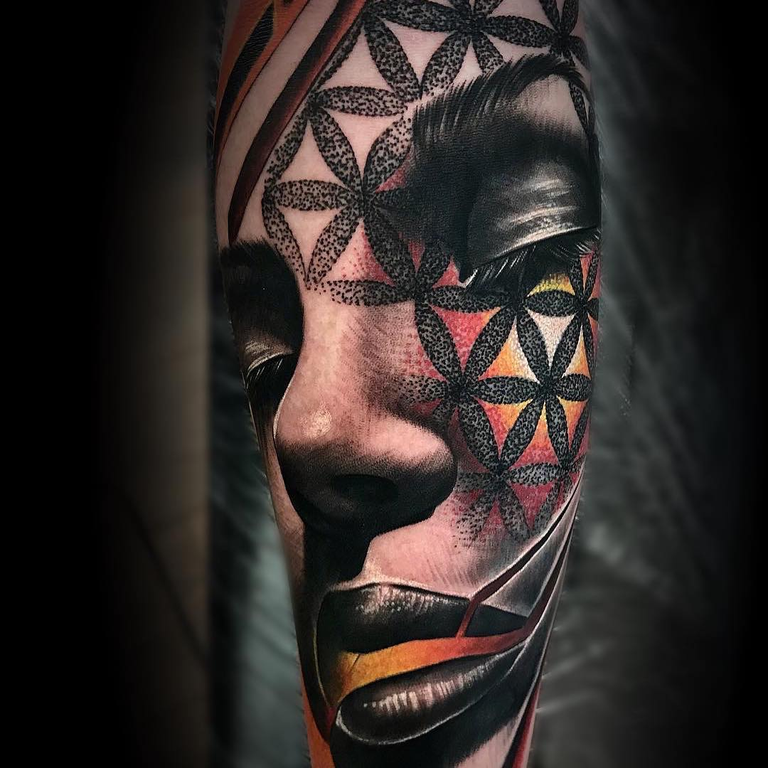 Colour Geometric Tattoo of a Womans Face by Martin Couley