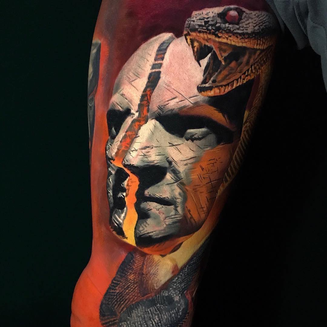 Colour Realism Tattoo of a Split Face and Snake