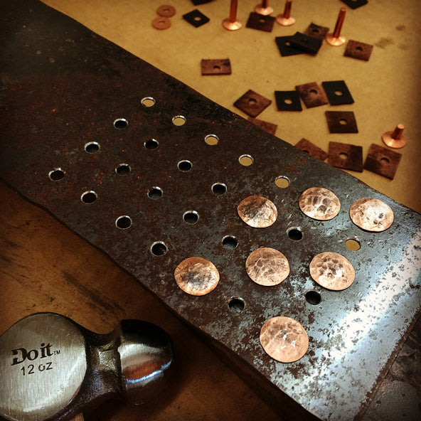 Hammered heads of copper rivets