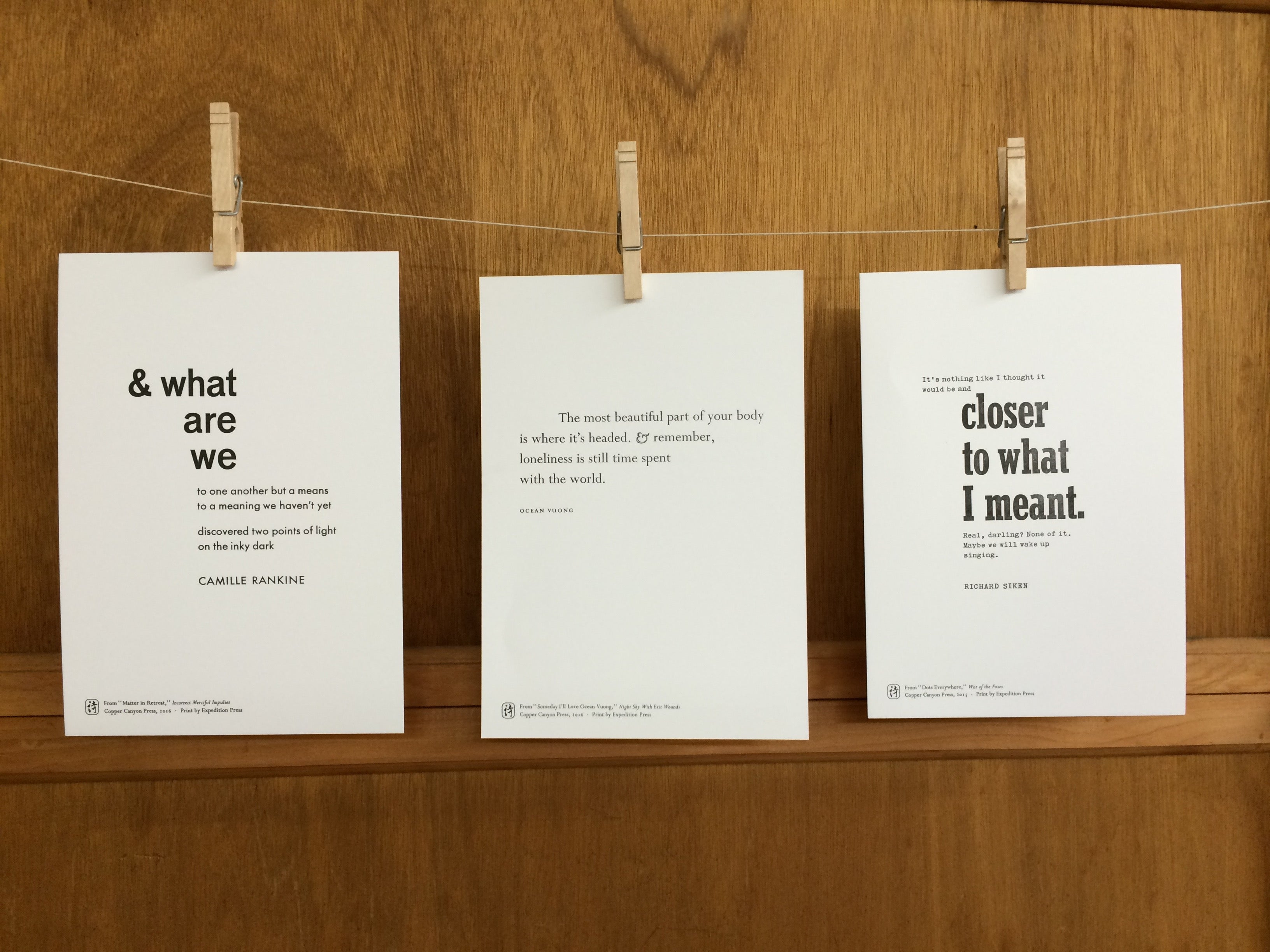 poetry fragments hung on a line