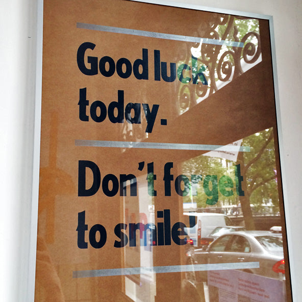 """letterpress poster reads """"Good luck today. Don't forget to smile."""""""
