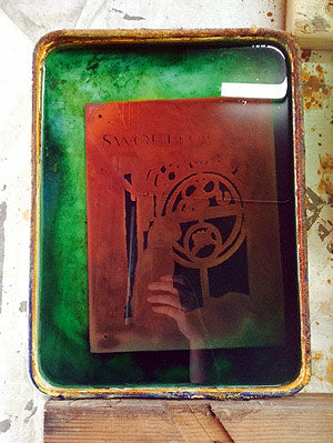 steel book cover in saline sulfate etching solution