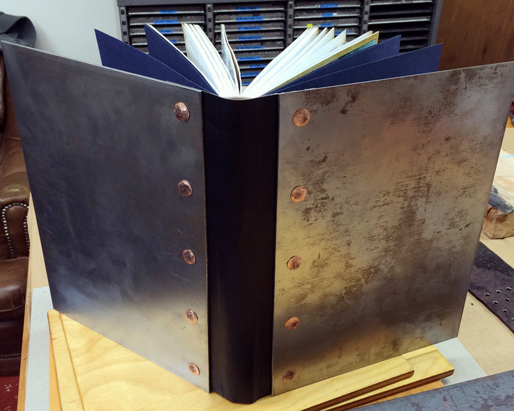 handmade book with steel covers