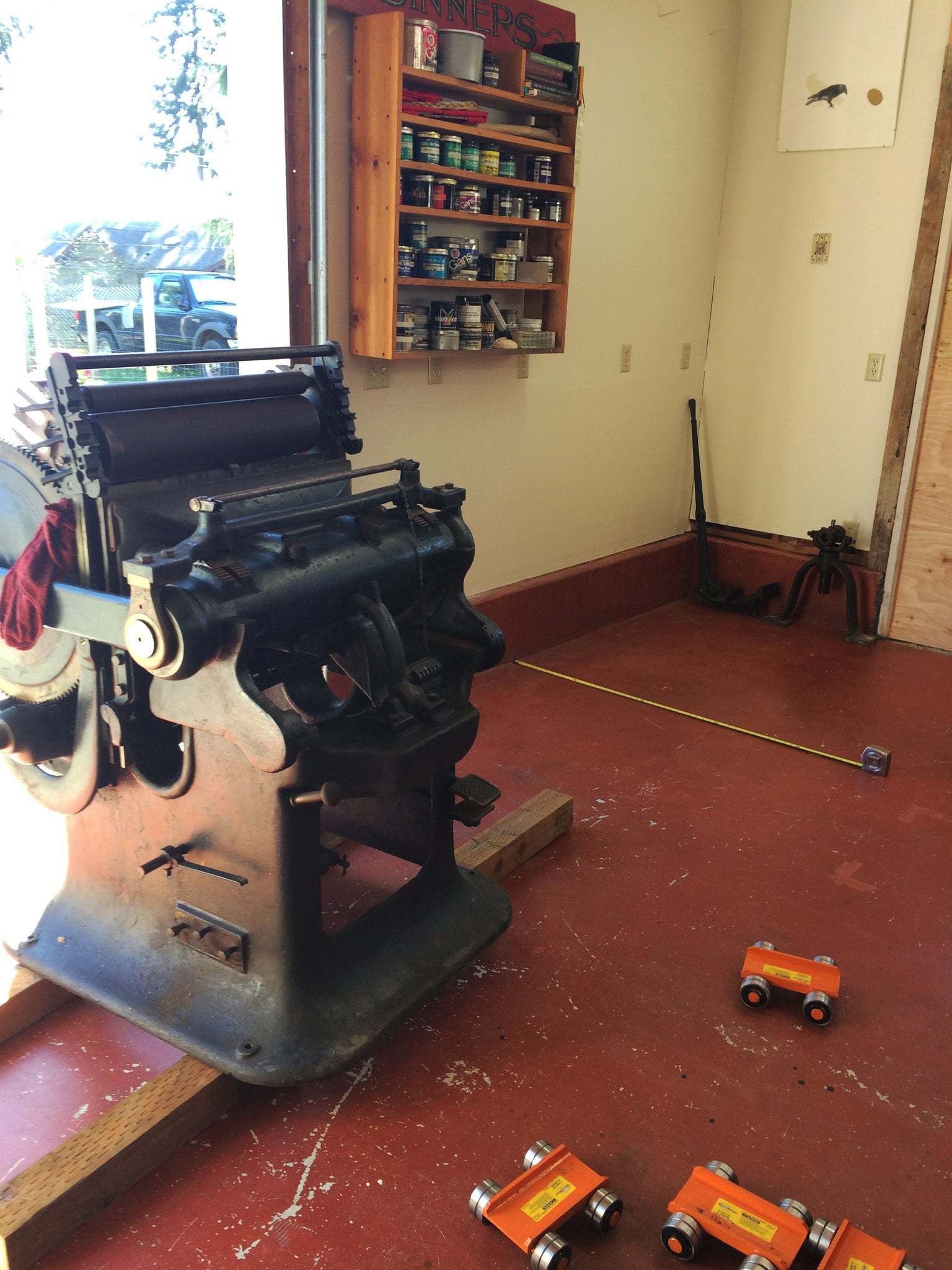 printing press moving into shop with red floor
