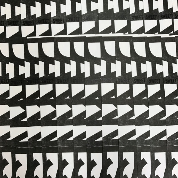 black and white patterned detail of overlapping prints