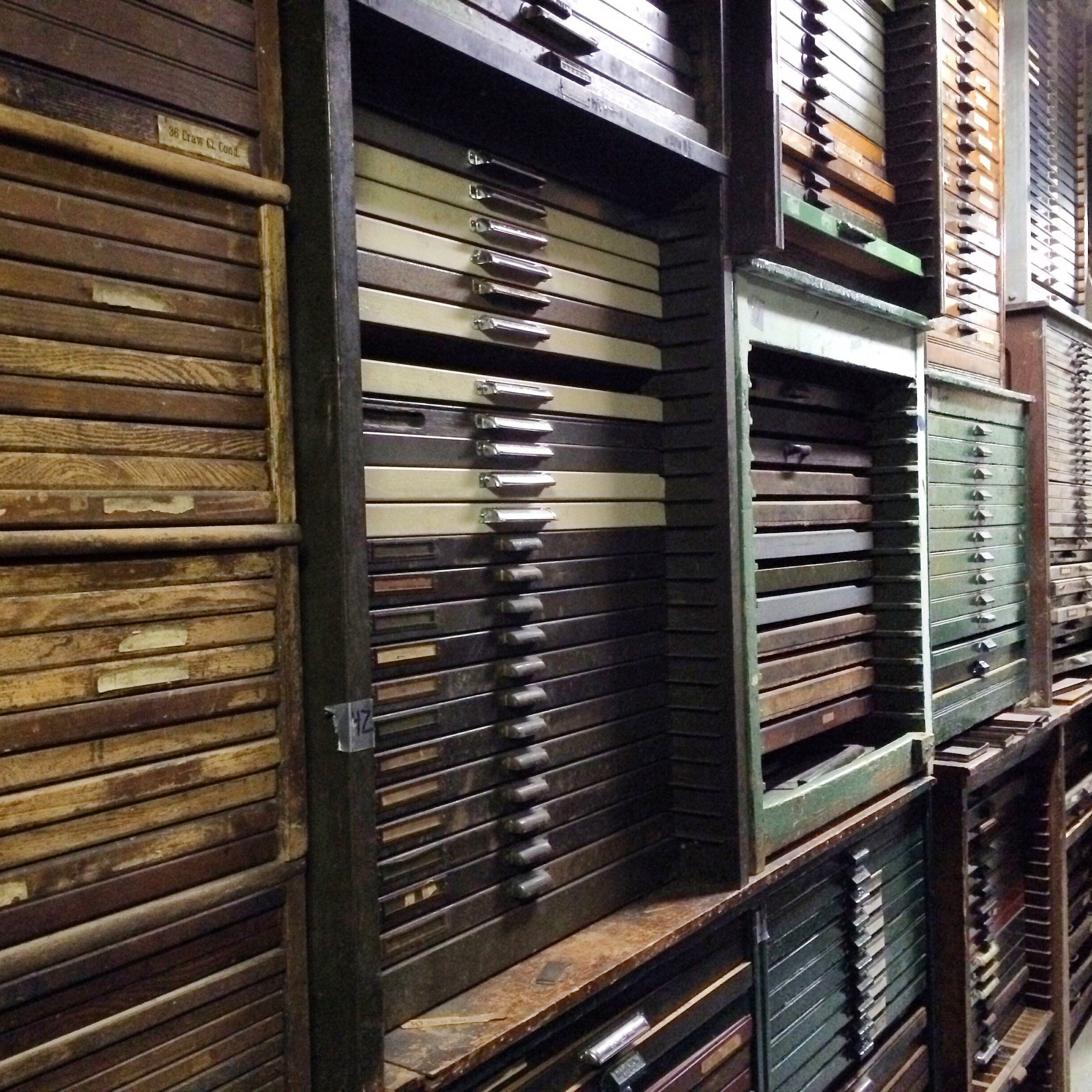 wall of type cabinets stacked three high
