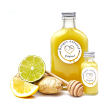 Load image into Gallery viewer, 200ml glass bottle of original ginger extract with 1oz honey, lemon, ginger shot