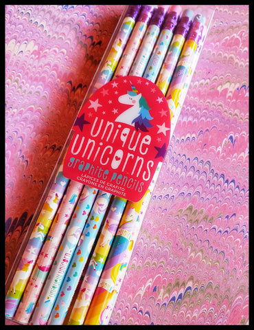 Uniquely decorated unicorn graphite pencils with erasers. 12 each blues, pinks, purple and yellow. 2 x 7.5 inches packaging ADA The Gilded Page Santa Fe
