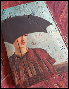 "Softcover lined journal 176 pages 5"" x 7"" women  with umbrella raining letters cover ADA the gilded page Santa Fe"