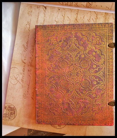 "Hardcover lined red & gold journal 144 acid-free pages 7"" x 9"" two latch locks folder in back of journal ADA The Gilded Page Santa Fe"
