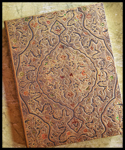 "Hardcover journal Inspired Koran cover. Lined 144 pages. 7"" x 9"". pocket in ack, acid-free pages. ADA The Gilded Page Santa Fe"