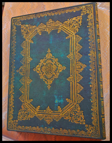 "Hardcover lined teal & gold journal 144 acid-free pages 7"" x 9"" folder in back of journal ADA The Gilded Page Santa Fe"
